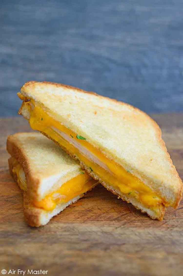 An air fryer hot turkey sandwich, cut in half.