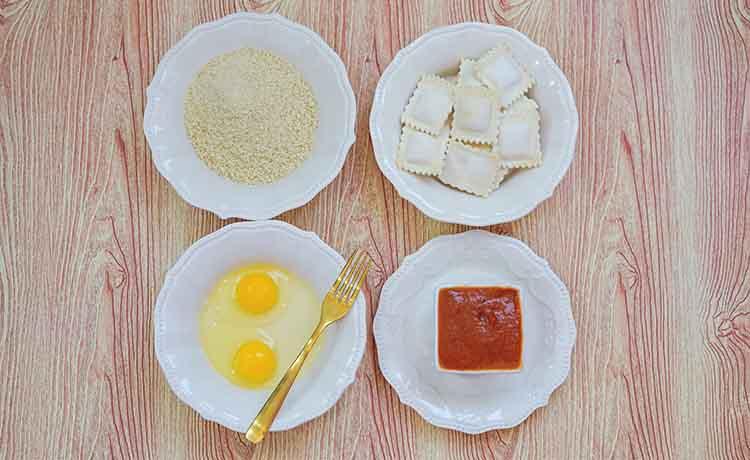 Mise en place, set up on a table for making air fryer ravioli.