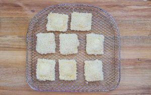 The prepped ravioli on the air fryer tray, ready to cook.