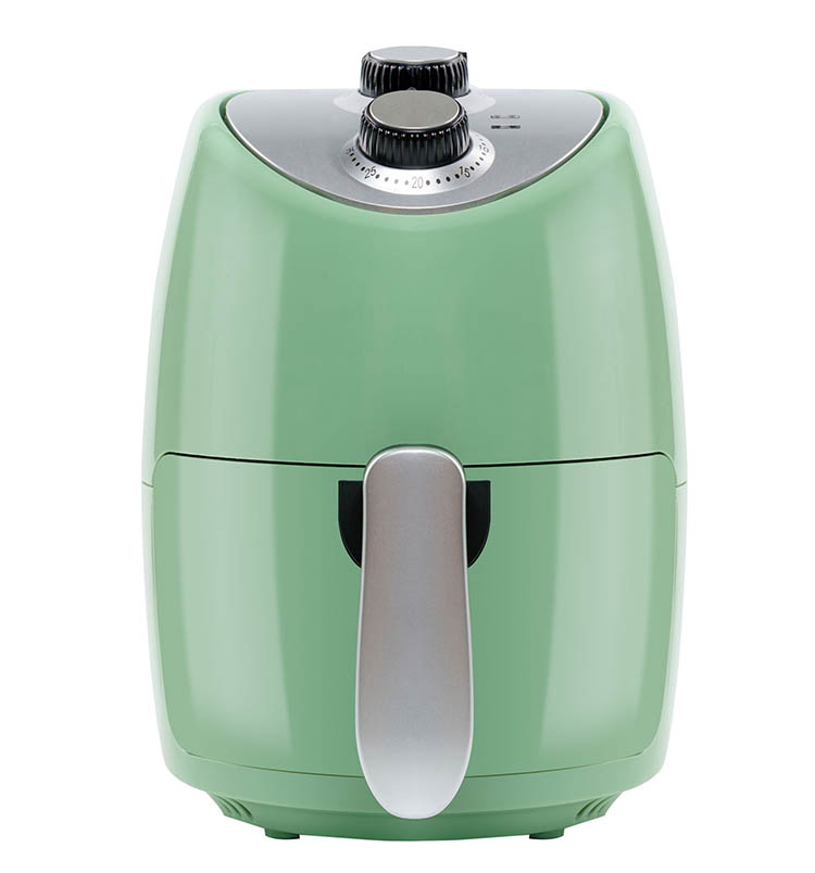 Air Fryer Guide For Beginners - Green air fryer on white background