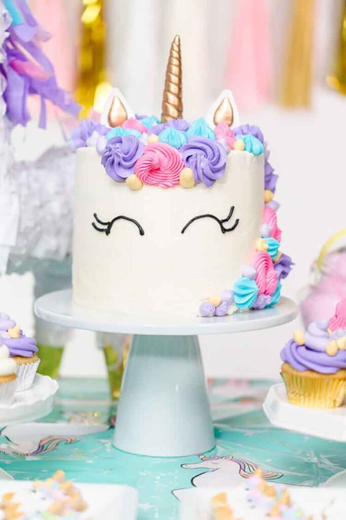 Can You Bake In An Air Fryer? Little girl birthday party table with unicorn cake, cupcakes, and sugar cookies