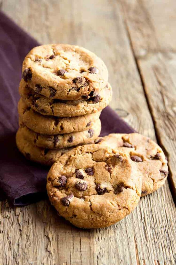 Can You Bake In An Air Fryer? Chocolate chip cookies on brown napkin and rustic wooden table