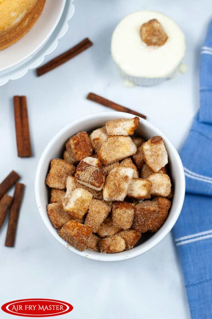 An overhead view looking down into a bowl of Air Fryer Churro Bites.