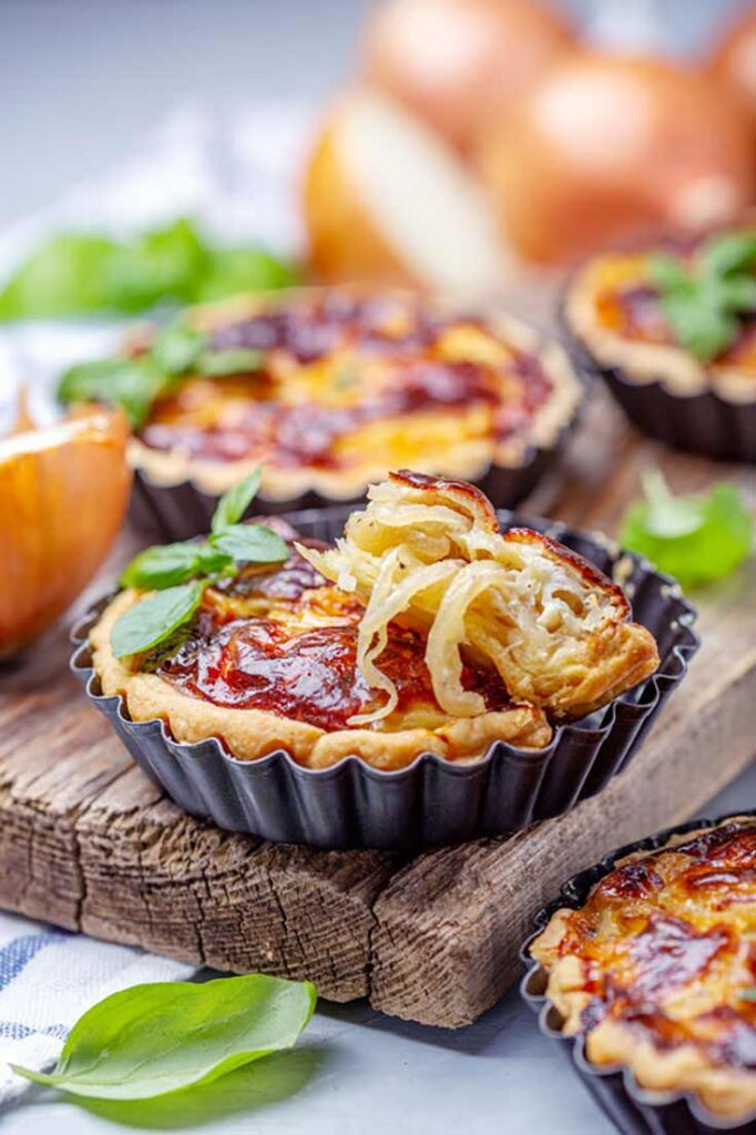 Caramelized Onion Quiche in tart pans.