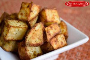 Air Fryer Breakfast Potatoes in a white bowl.