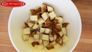 The chopped potatoes in a large mixing bowl