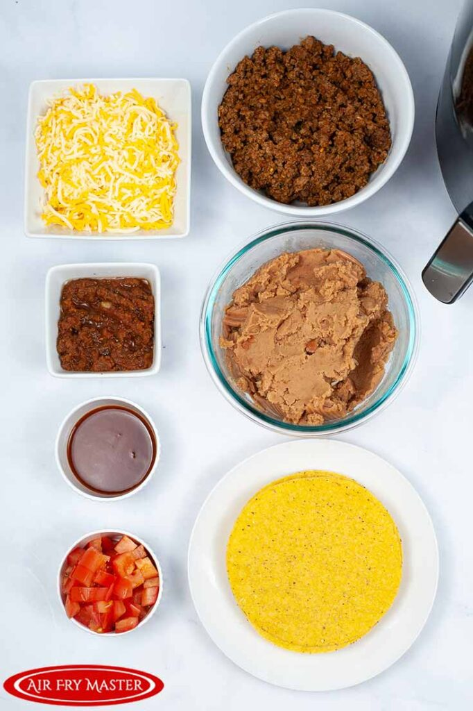 All the ingredients for this Air Fryer Copycat Taco Bell Mexican Pizza Recipe in individual bowls, sitting in two rows.