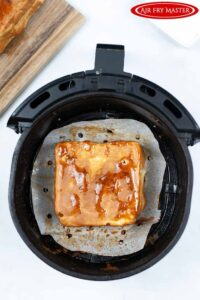 The just cooked Air Fryer Monte Cristo Sandwich sitting in the air fryer basket.