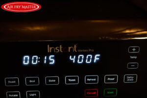 Time and temperature displayed on the front of the air fryer.