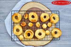 Browned donuts on a cooling rack.