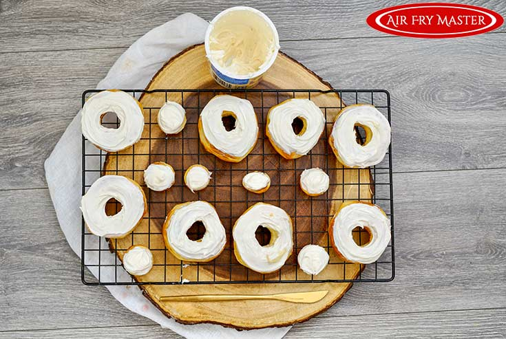 The frosting spread on the donut tops from this air fryer donuts recipe.