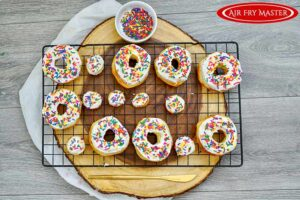 Sprinkled sprinkled over the frosted donuts.